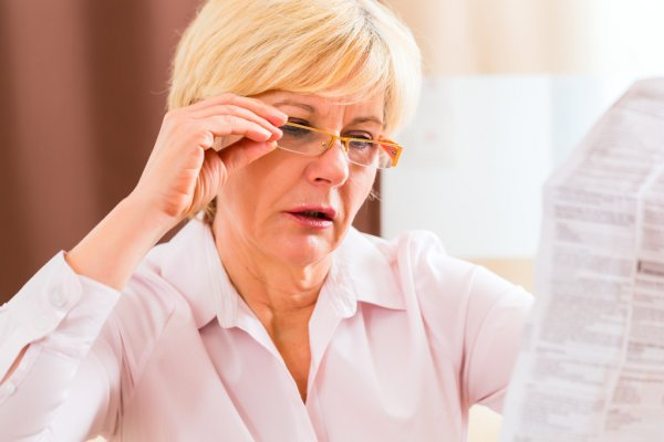 depositphotos_68453543-stock-photo-senior-woman-reading-with-presbyopia