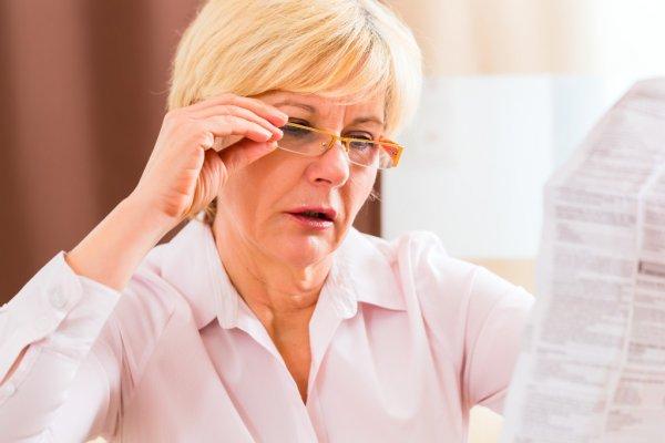 depositphotos_68453543-stock-photo-senior-woman-reading-with-presbyopia